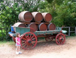 An old wagon with wooden barrels