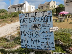 A hand-painted sign indicating that Willeen's does many things