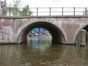 A bridge and side canal we see from our boat