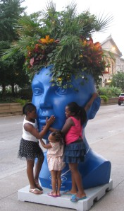 Many giggles as these kids 'hugged' the statue