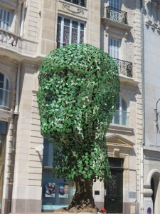 Outdoor art: green metal head in Place Rude, Dijon