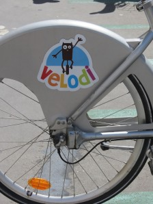 Dijon's bike share program is called Velodi, with a cute mascot of the famous Dijon owl