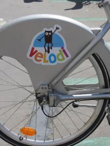 Dijon's bike share program is called Velodi, with a cute mascot of the famous Dijon owl