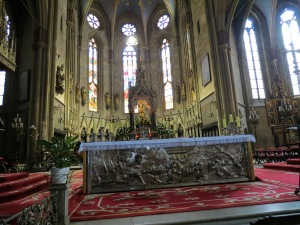 Beautiful cathedral interior and ornate silver altar