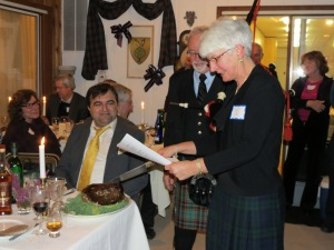 Ann C recites The Address to a Haggis, and plunges the knife in to cut it