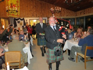 The piper pipes in the haggis, carried by Roy C