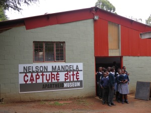 A group of school kids visit the small Apartheid Museum on site