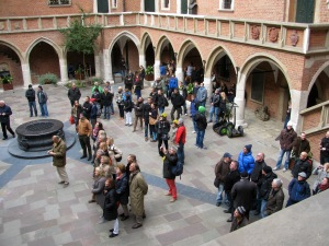 Crowds gather in the courtyard to watch the animated clock procession