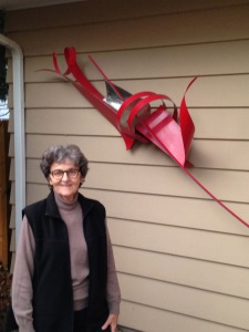 Christiane Martens stands by one of her small pieces outside her home in Urbana