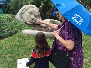 My granddaughter and I point out features of the sculpture