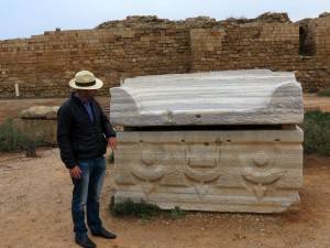 Danny Hermann points out a feature on a sarcophagus