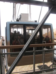 The cable car arrives at the top