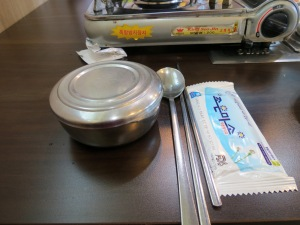 Rice bowl, chopstick and spoon at place setting