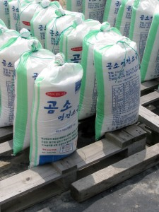Selling bags of salt in Korea---obtained from evaporating salt ponds