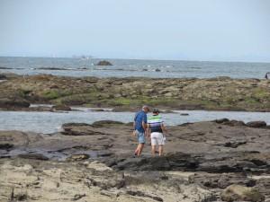 Rod M and Chang K walk onto the rocks